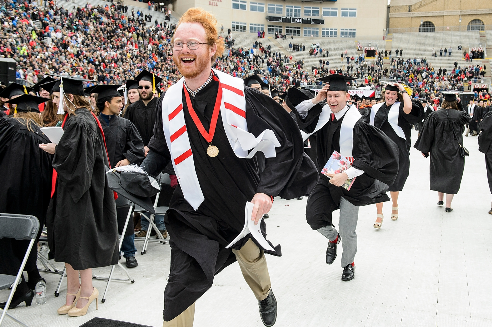 James Holden, Comprehensive Honors Candidate, celebrates Commencement at Camp Randall Stadium in May, 2016 wearing his Honors stash and Comprehensive Honors Medallion